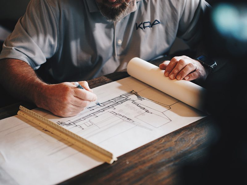 Architect reviewing blueprint drawing for new commerical property